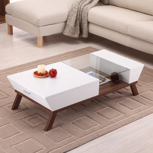 Here's another hybrid design, a modern table infused with built-in storage in a striking display of contemporary fashion. A single glass piece covers a display shelf, while both ends open up to reveal storage compartments.