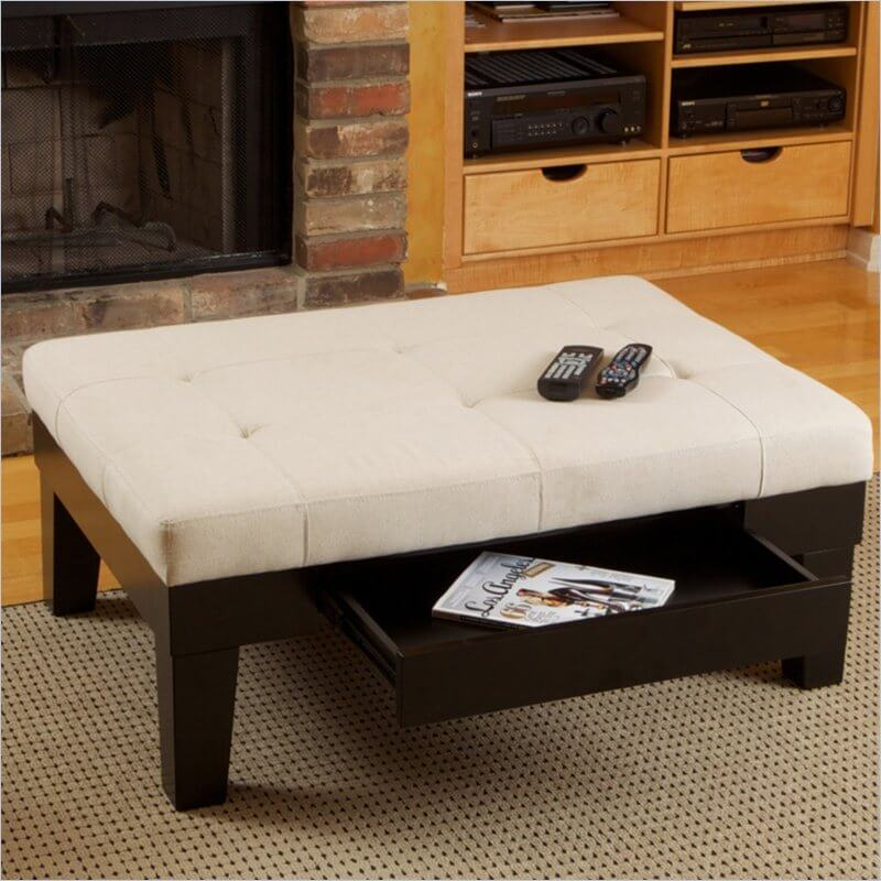 This high contrast ottoman design features a thick, button tufted surface in light beige over a dark wood frame. A pull-out drawer adds some useful storage for remotes and reading materials.
