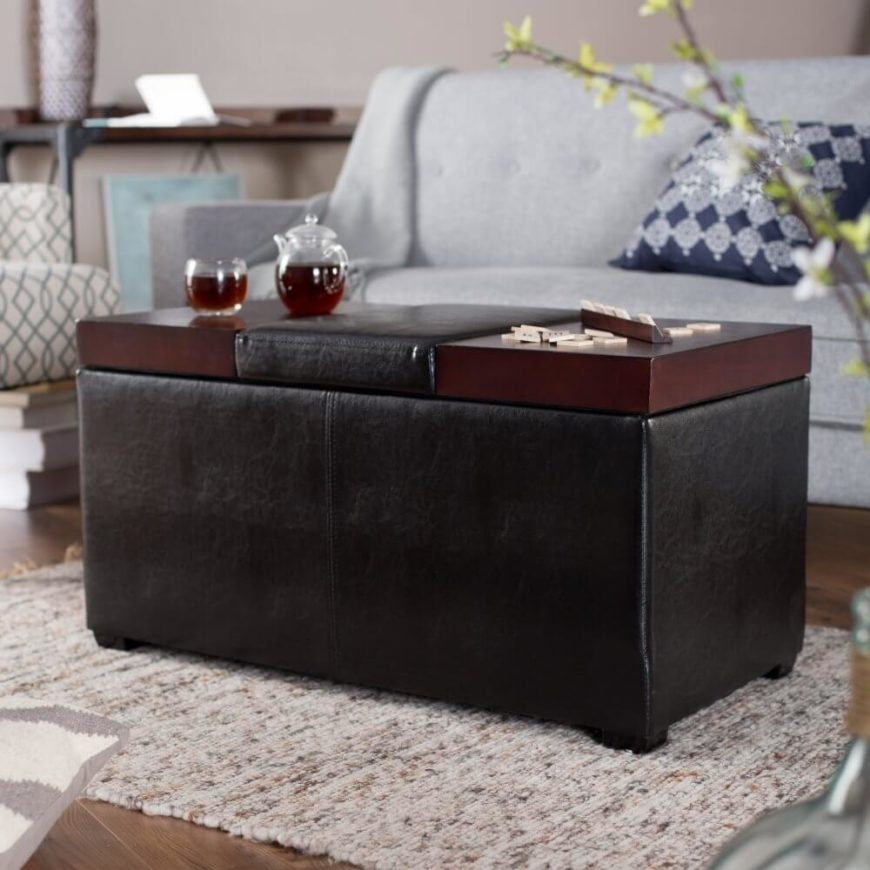 This large rectangular ottoman hybrid features a surface made of discrete panels that can be lifted, moved, and flipped. With a cushion section at the middle, the sides are free to act as a coffee table with sleek wood, contrasting with the black leather body.