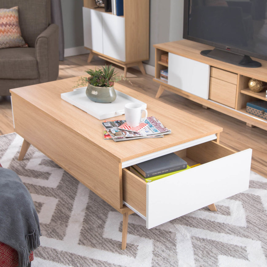 Light natural wood matches with sleek white drawer faces in this fat bodied coffee table. Storage drawers emerge from each end of the boxy frame in stylish fashion.