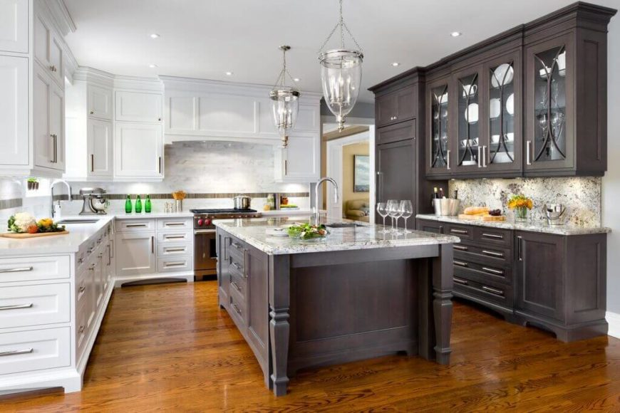 U-shape kitchen with hardwood flooring and a large center island with mixed white and dark brown cabinetry.