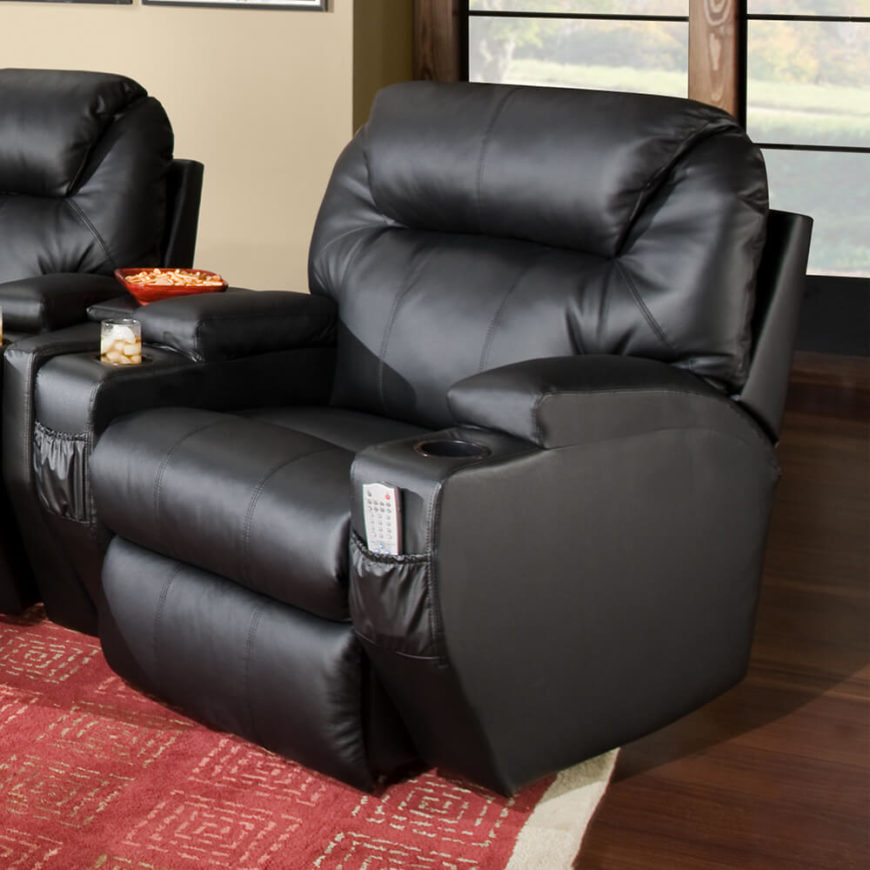 This broad, ultra-thick cushioned black leather chair is the perfect movie time companion, with huge armrests, cupholders, and remote baskets built in. The reclining action can leave you completely horizontal, if you're aiming for complete comfort.