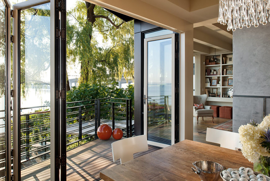 Here's one of several sets of folding glass doors that can be retracted to essentially blur the line between indoors and out. Through the large opening, nature looms into view.