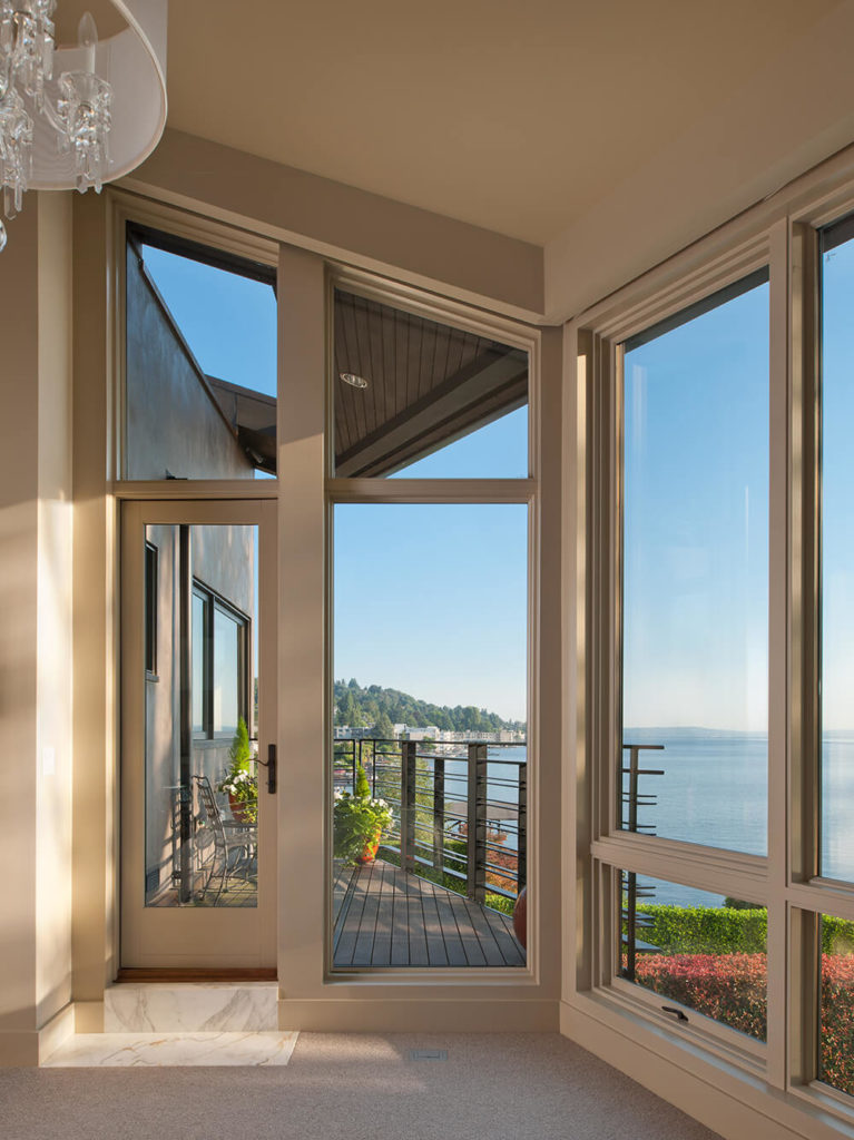 From inside the home on every floor, panoramic views of the lake and surrounding environment are available. Decks hang on every level for direct outdoors experience.