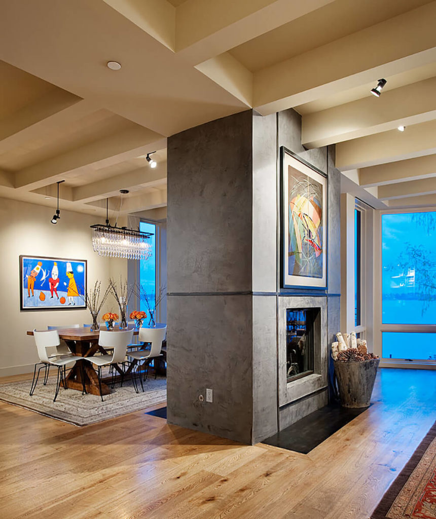 Here's a detailed view of the free standing fireplace wall, which provides access on both sides and acts as a room divider within the large open space.