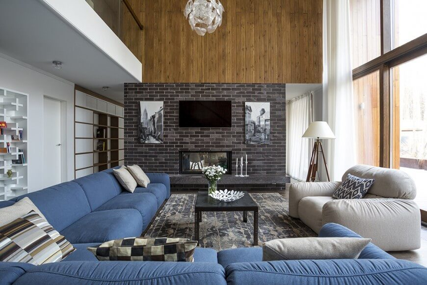 Here is another example of a little brick making a big impact. Supporting a fireplace, two paintings, and a flat screen television, this brick arrangement helps center the room.