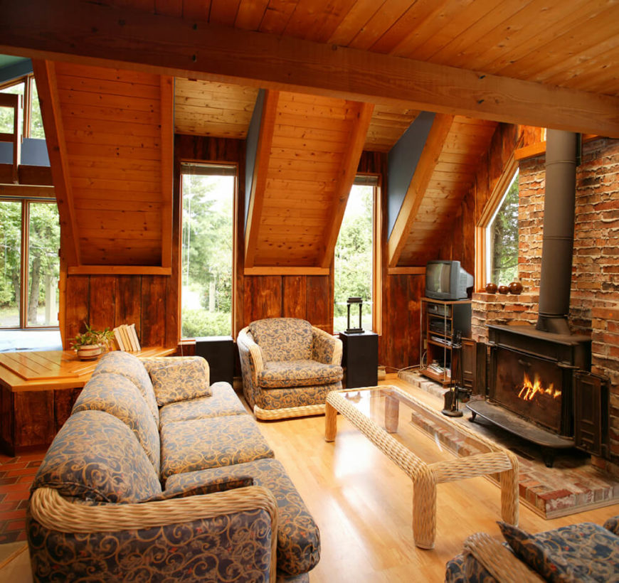 Few things are as cozy as brick. In this living room,the stained wood blends perfectly with brick fireplace.