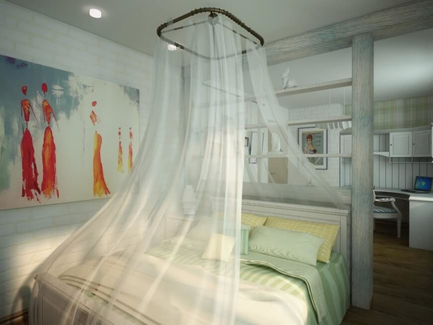 This bed canopy is draped around nearly the entirety of the bed, while light shining in from the windows provides a peaceful atmosphere. Behind the bed, there is a corner desk with plenty of space for storage in the overhead cabinets, as well as plenty of desk space for working.