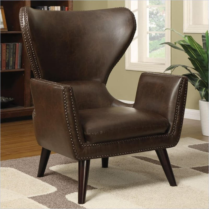 The combination of traditional leather upholstery and nail head trim with a unique, attention-grabbing design make this chair a great choice for those going for transitional look between modern and classic aesthetic. Thin cut arms, tapering legs, and a fanning back make the design stand out, while the extra soft cushion and smooth back ensure comfort to compliment the style.