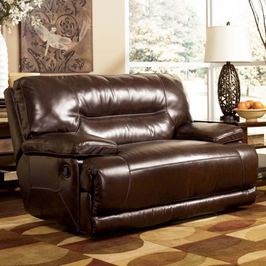 A massive, wide-style faux leather recliner, this chair and a half practically begs you to sit back and relax. The sinuous spring system, cushioned back, and pillow top armrests are designed to maximize comfort, and the easy-to-clean upholstery helps protect it from any man cave shenanigans.