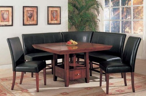 The most unique feature of this corner dining set is the rich wood table with built-in storage drawer and lower shelf. This allows you to keep dining accessories at hand in a neatly concealed space, while enjoying the rich black leather upholstery and curved corner seating.