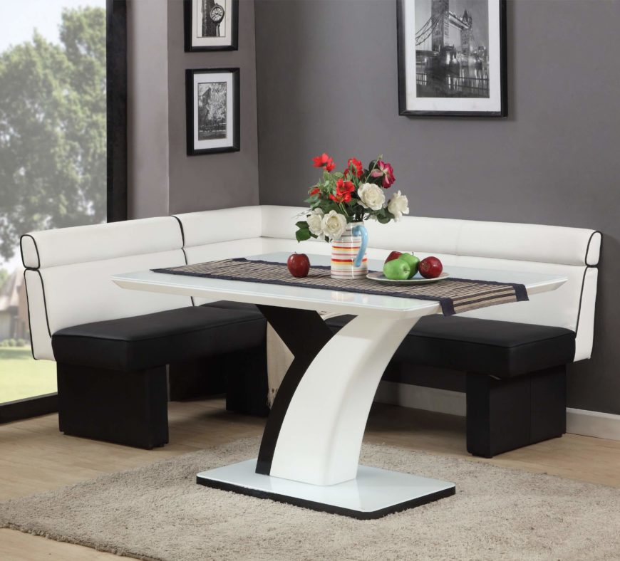 Moving even further into sleek modernism, this black and white corner dining set flaunts is elegant, glossy look with a curved criss-cross table base and high contrast faux leather. The table itself features a sleek white glass surface, sure to heighten any contemporary setting.
