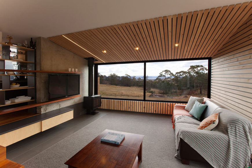 This angle reveals a view from next to the stairs, and shows the interior of the living room walls. The material is consistent with the outdoor patio areas.