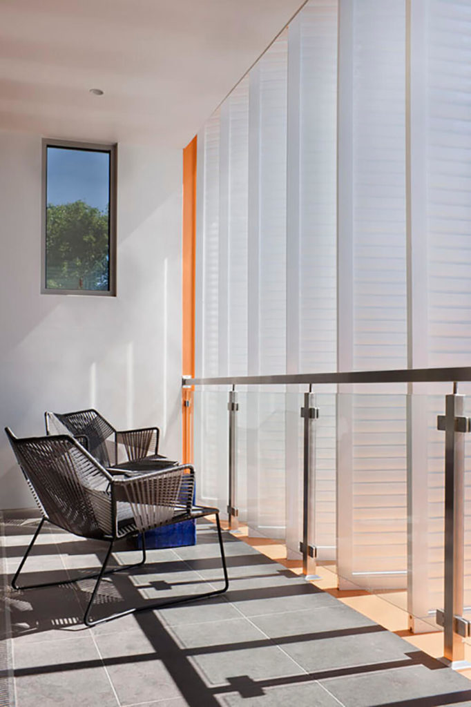 A small patio off the primary bedroom completes the sitting area. With large sliding glass doors that can be left open for some fresh air or closed off to offer privacy, this little space is a welcome addition to the open design of the bedroom.