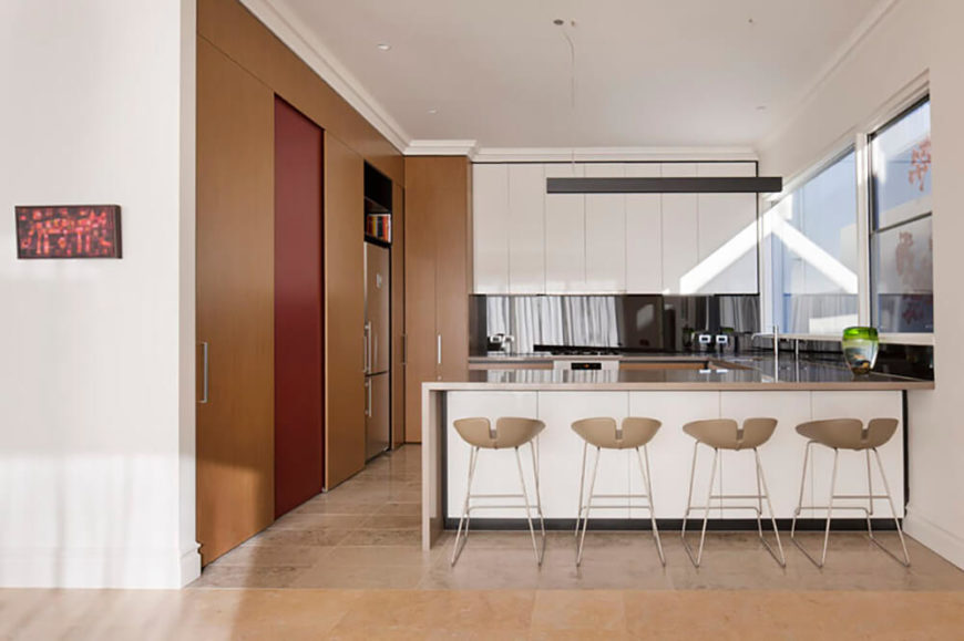 The remodeled kitchen needed to maintain a better flow of work and provide more room for the growing family.