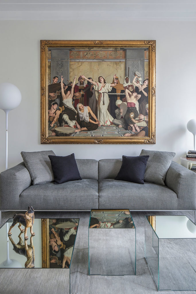 Directly facing the couch in this room, you get a full view of this fine art. This image reveals a perfect example of how pieces of the old and new work together to form a complete design.