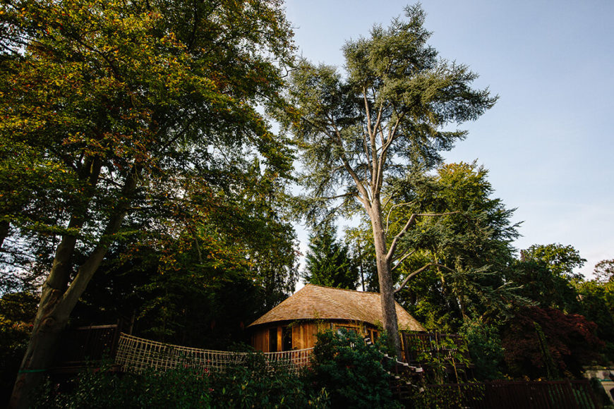 Despite all of the features in this treehouse, the exterior remains low-key and understated so that it is noticeable but not overbearing to the landscape. Here you can see that it melds perfectly with the surrounding trees and foliage.