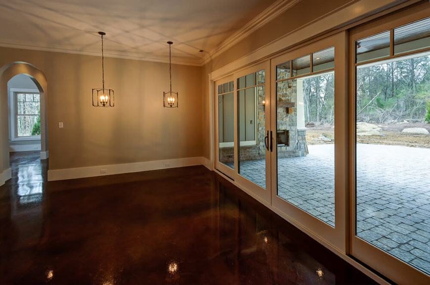 The dining area is open to the rest of the kitchen and looks out onto the back patio through large sliding glass doors.
