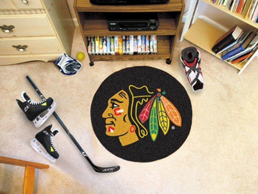 Sometimes you just need a floor mat, but sometimes you want one that really makes a statement. When it comes to your own man cave, why go for the bare minimum when you can personalize every corner of the space? We love the idea of a hockey puck floor mat, customizable to your favorite team's logo.