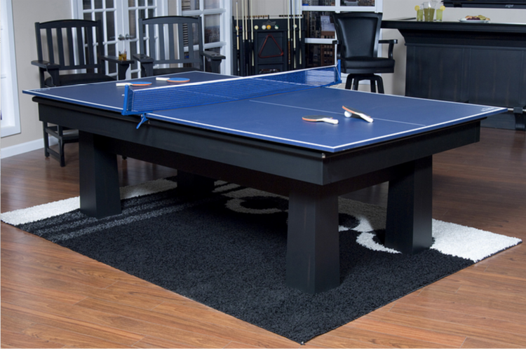 Here's a stone cold man cave classic. Ping pong tables have appeared anywhere men have gathered for decades now, and are a staple of late night camaraderie. We love the blue finish and thick wood construction of this particular table, making not only a fun but a handsome addition to a man cave of virtually any style. Paired with a rug, as seen here, it can be the centerpiece of your space.