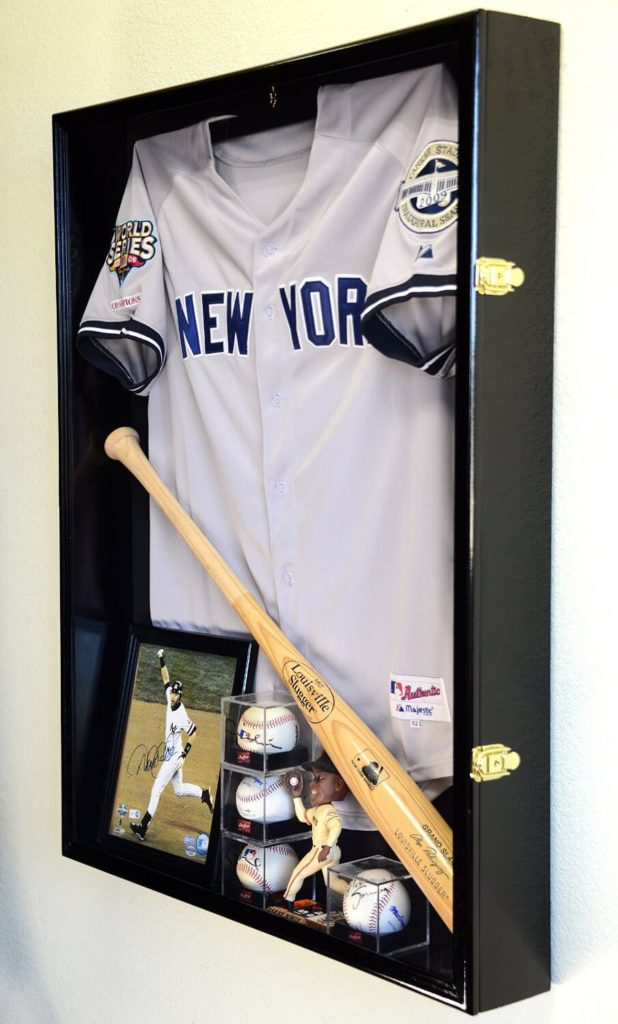 Similar to the above model, this gorgeous black stained wood shadow box is designed to show off another type of important memorabilia: the jersey. Your coveted jerseys will be kept immaculate by the built-in UV Protection, while the discreet shape and ample size ensures that you'll be able to gather all your important baseball items in one space.