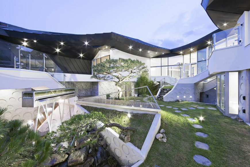 At night, the courtyard sparkles with the glow of dozens of subtly recessed lights dotting the landscape from top to bottom. The gorgeous interplay of natural and sculpted forms makes for a visually arresting space.