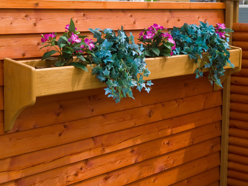 Long a Germanic tradition, hanging flower boxes below windows isn't limited to The Continent. This method has many advantages, including the fact that budding flowers won't conceal the world beyond your flower box.