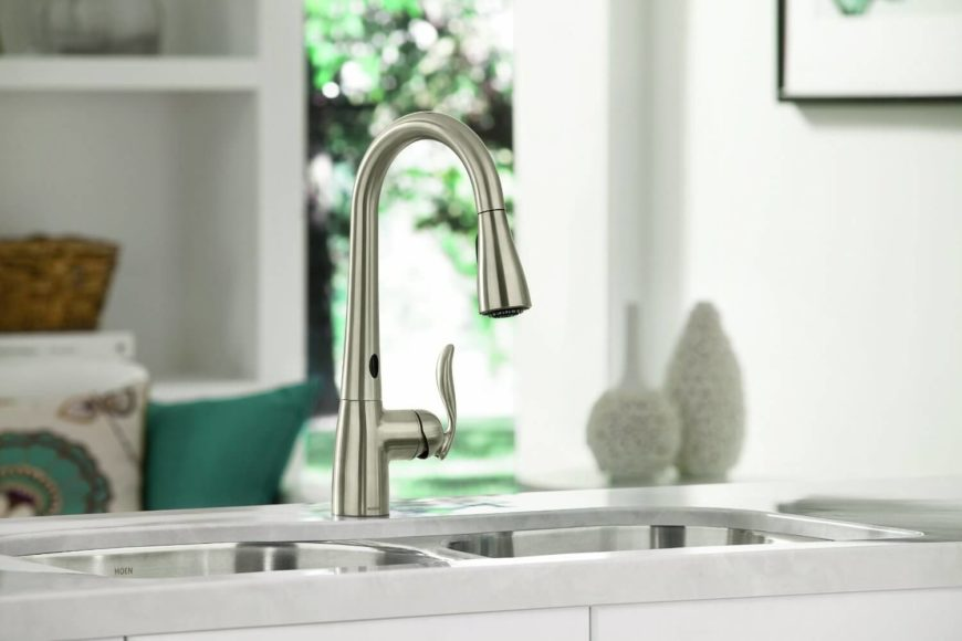 This one-handle high arc pulldown kitchen faucet features a unique hands-free feature, courtesy of a motion sensor built right in. Without having to touch the faucet, you can activate water flow using simple hand movements. You can get right to cleaning without getting dirt, grease, or other residue on your faucet itself. Even better, it's great for reducing the spread of germs. A surprising feature allows the faucet to stop the flow of water as it passes over the countertop, reducing the chance of spills.