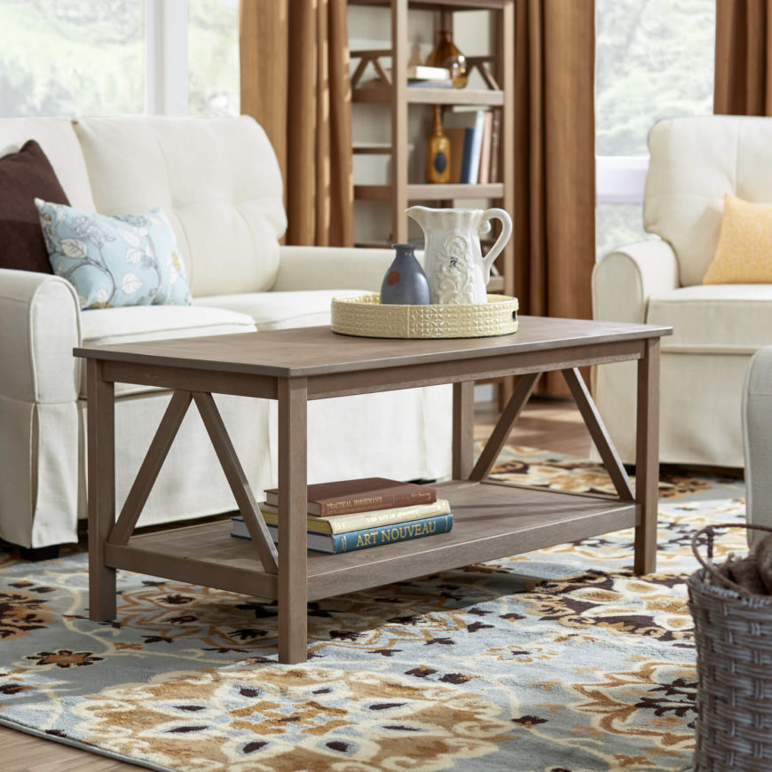 While this coffee table appears, at first glance, not unlike the model above, there's a key distinction. We chose a pair of tables with the same rough structure to highlight just how important the tone and grain of wood is in a piece of highly visible furniture. The lighter, aged look of this table brings an entirely different mood to the room.