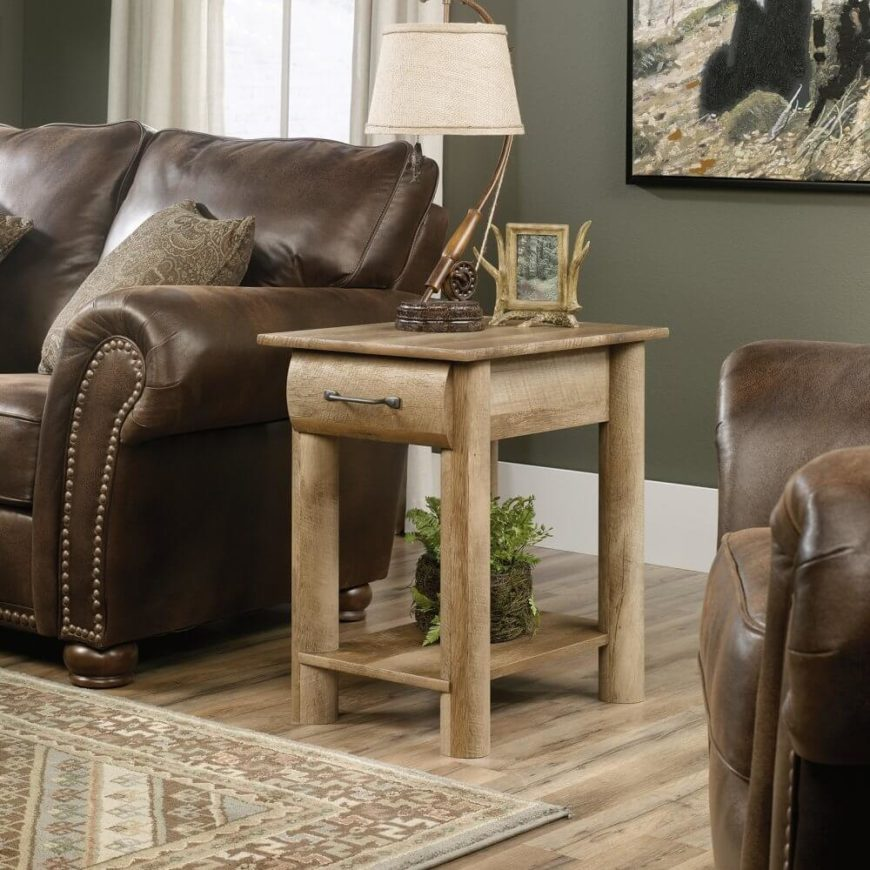 Matching one of our coffee table choices above, this rustic styled side table would make the perfect complement, uniting a living room with simple curved natural wood elegance and a light tone that works great in contrast to darker furniture. The thick legs and unadorned surfaces make for a sturdy, no-nonsense presence in any living room.