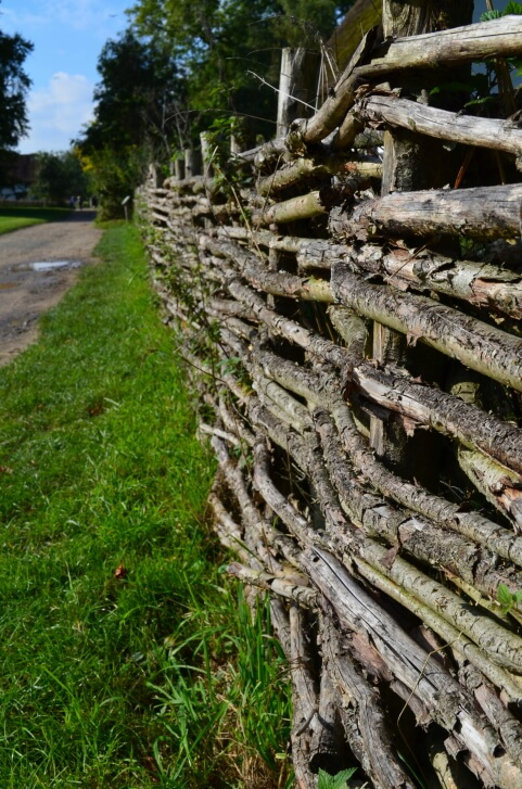 Check out this natural branch fence - a very natural and wild aesthetic.