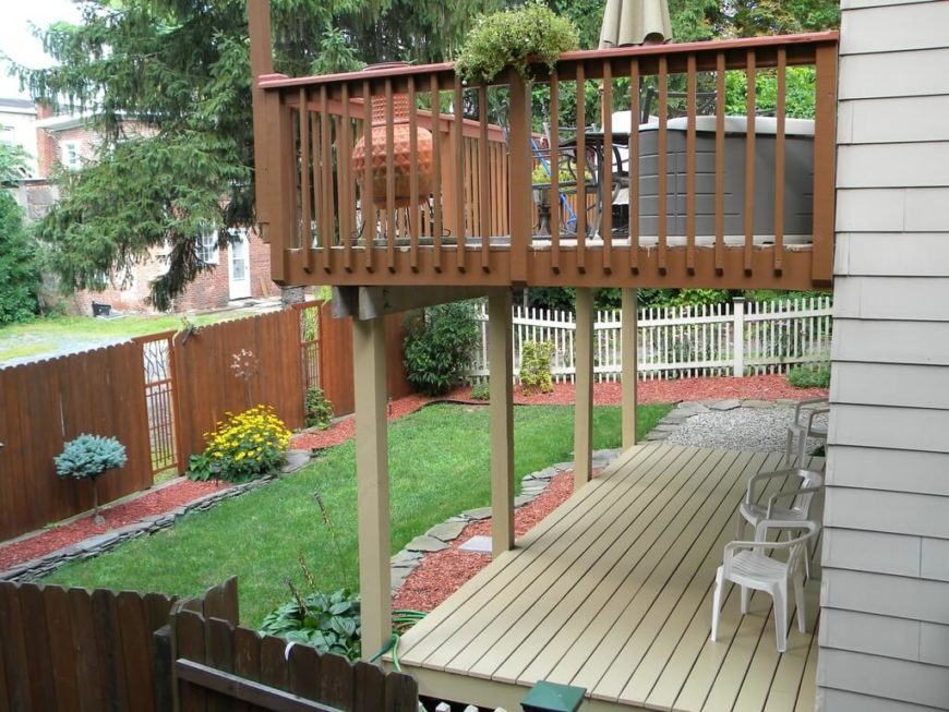 This simple fence design is broken up with design panels.