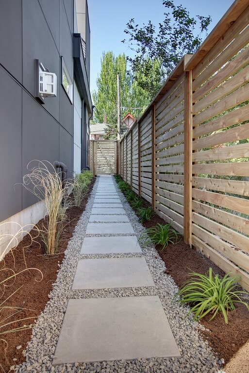 With a small spacing in the slats of a fence, light is allowed to pour through.