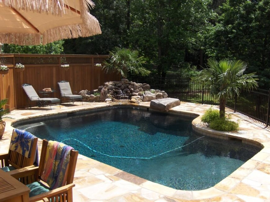 This fence mixes an iron bar fence with a taller wooden fence. Mixing fences can vary the look of your pool fence.