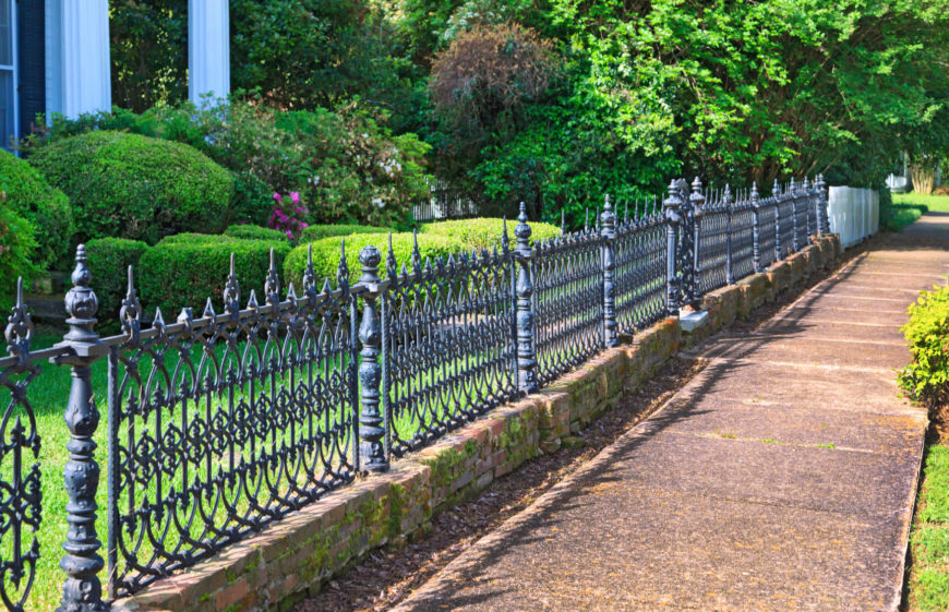 A lovely waist high wrought iron fence, with detailed and attractive panels.