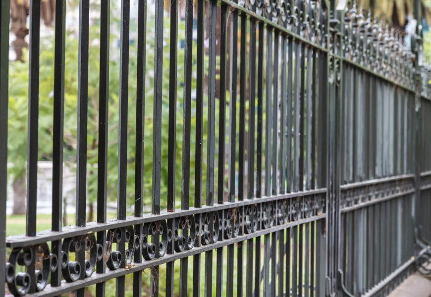 A simple but still elegant wrought iron fence idea.