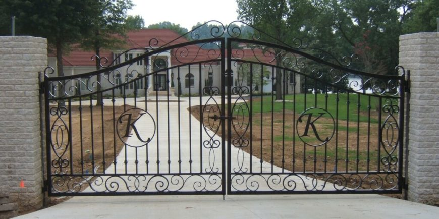 Large intricate custom wrought iron gates are a perfect first impression when entering this home.