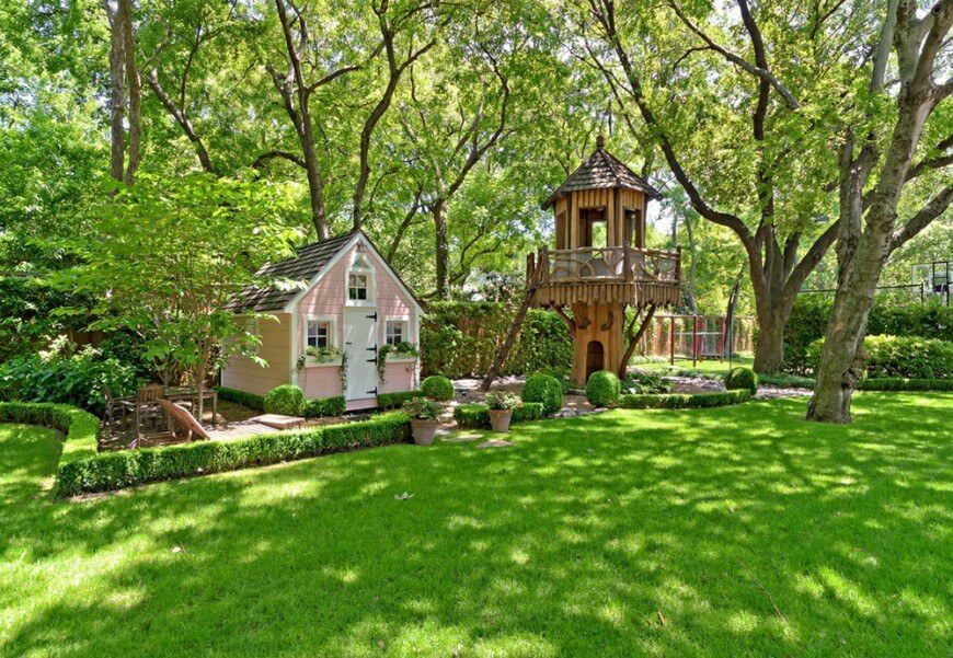 This playground includes a fantasy-style treehouse and a quaint cottage play house.