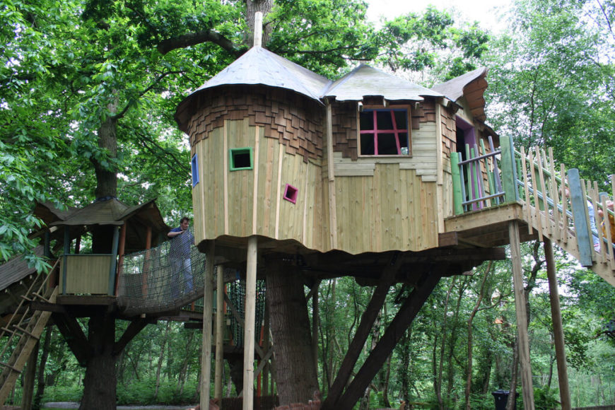 Adding a bit of color and rope bridges to a treehouse really allows the kids to branch out and find new ways to play.