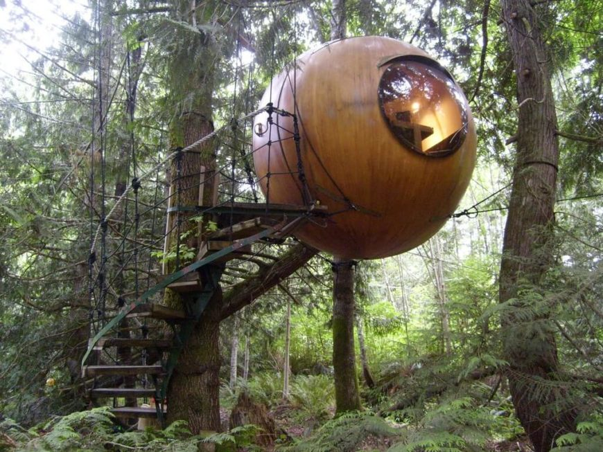 This design is really innovative, featuring a globe-like cabin and a large spiral rope bridge
