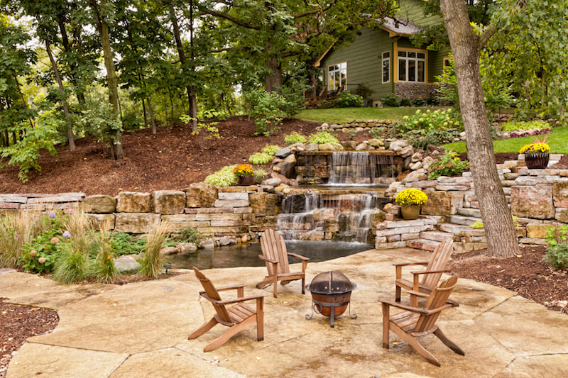This fire pit is located on a small pond-side patio down the hill from the home. It's small, but easy to move around or into storage during winter months.