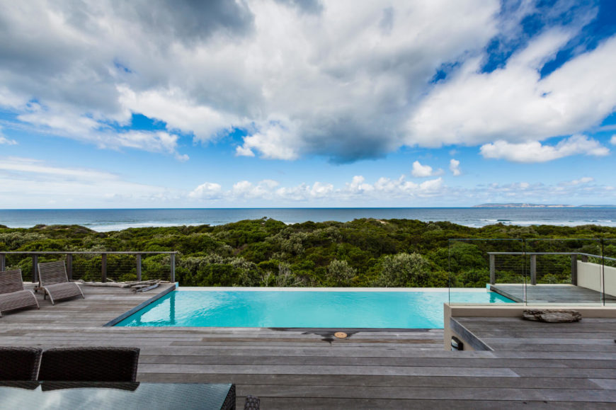 A stunning infinity pool integrated into this deck overlooks a stunning view. With limited landscaping opportunities with this space a small pool is a great addition.