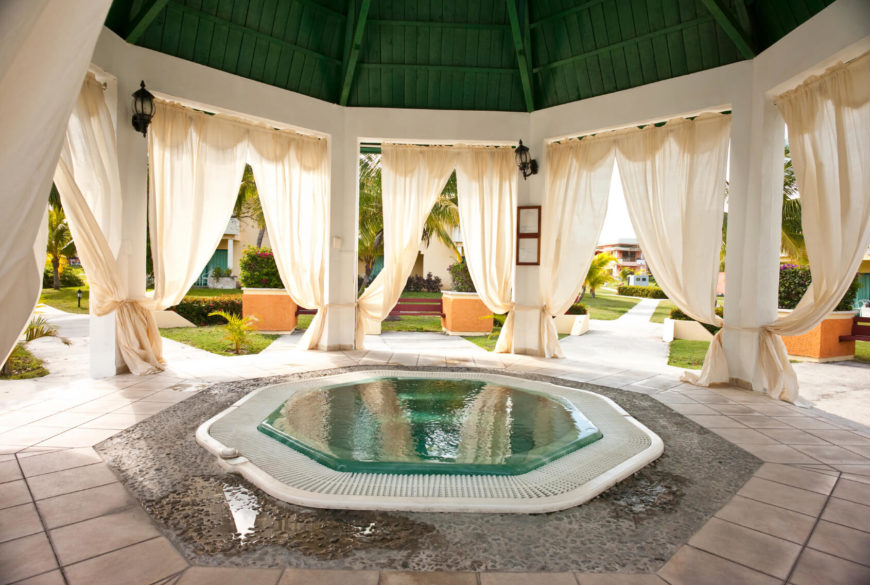 A gorgeous hexagonal dipping pool under a pagoda. This is an amazing design for a small pool. It is a very romantic spot for couples to retreat to.