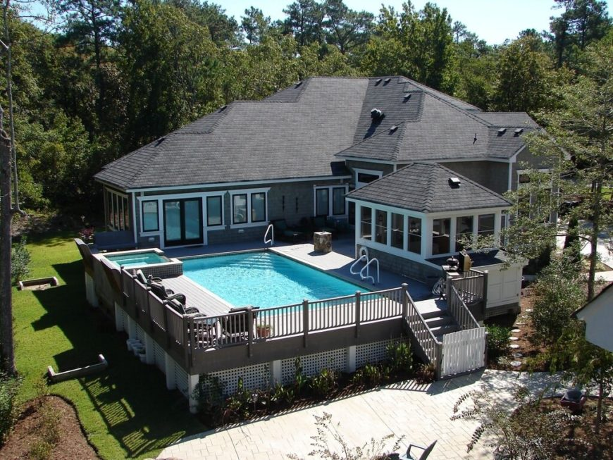 This rectangular above-ground pool it entirely surrounded by deck. This makes this pool feel nearly identical to a in-ground pool.