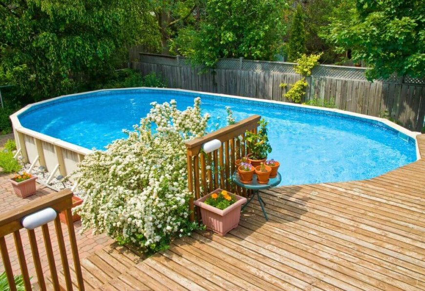 This is an oval, above ground pool. The oval shape is visually appealing, and with some landscaping, appears more organic.