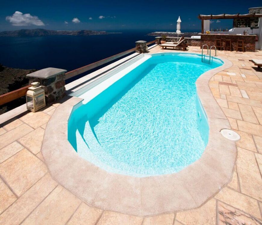 A classic kidney design, on a high up patio overlooking the ocean. This pool is a perfect use of the space available, creating a relaxing place over the spectacular scenery.