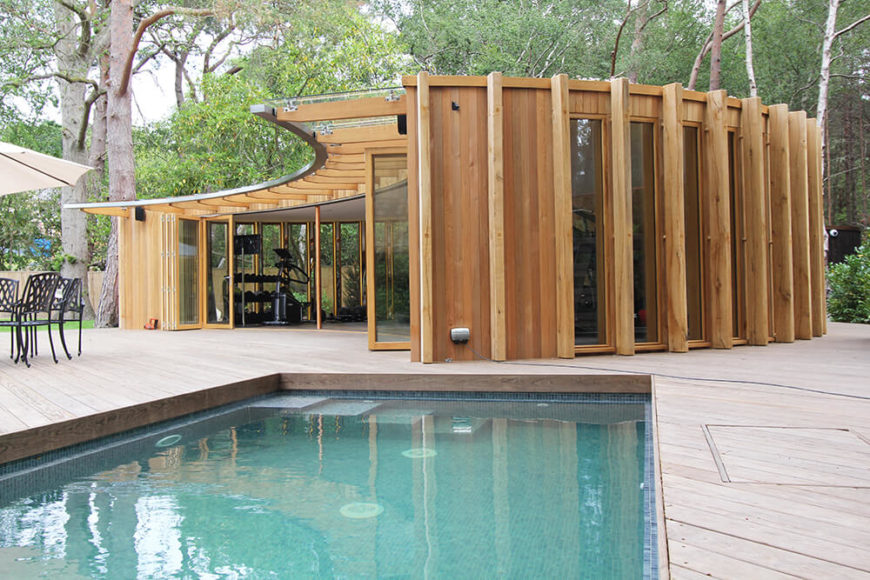 On the other side of the backyard is the Lake House, which has many windows, including accordion style windows that open to expose the gym to the breeze. The pool is only a few steps away.