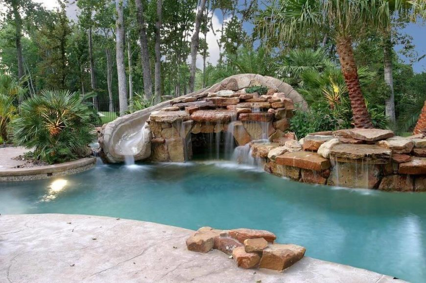 This is a detailed slide with a faux stone design set into some stone and waterfall landscaping. With the waterfalls around the slide the water coming down the slide fits into the running water motif, and just ads to the water features.