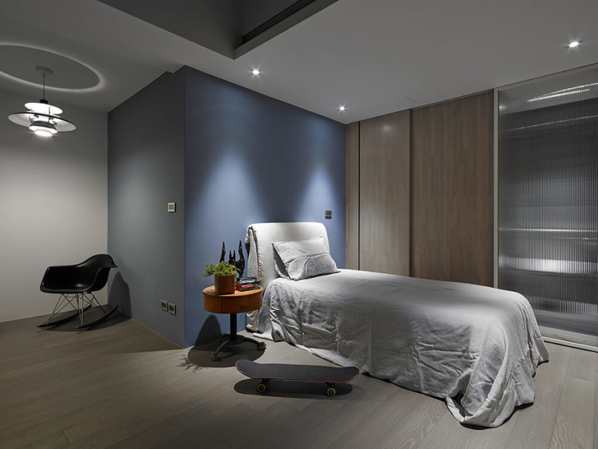 Here's a secondary bedroom, designed for the teenage boy. Its sparse look is countered by an array of subtle colors not seen elsewhere in the home.