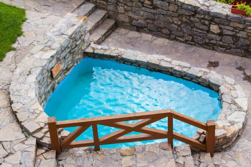 This pretty plunge pool is surrounded by wonderful stone work. It mixes rustic and luxury perfectly. This would be an amazing pool to soak in after a working out.